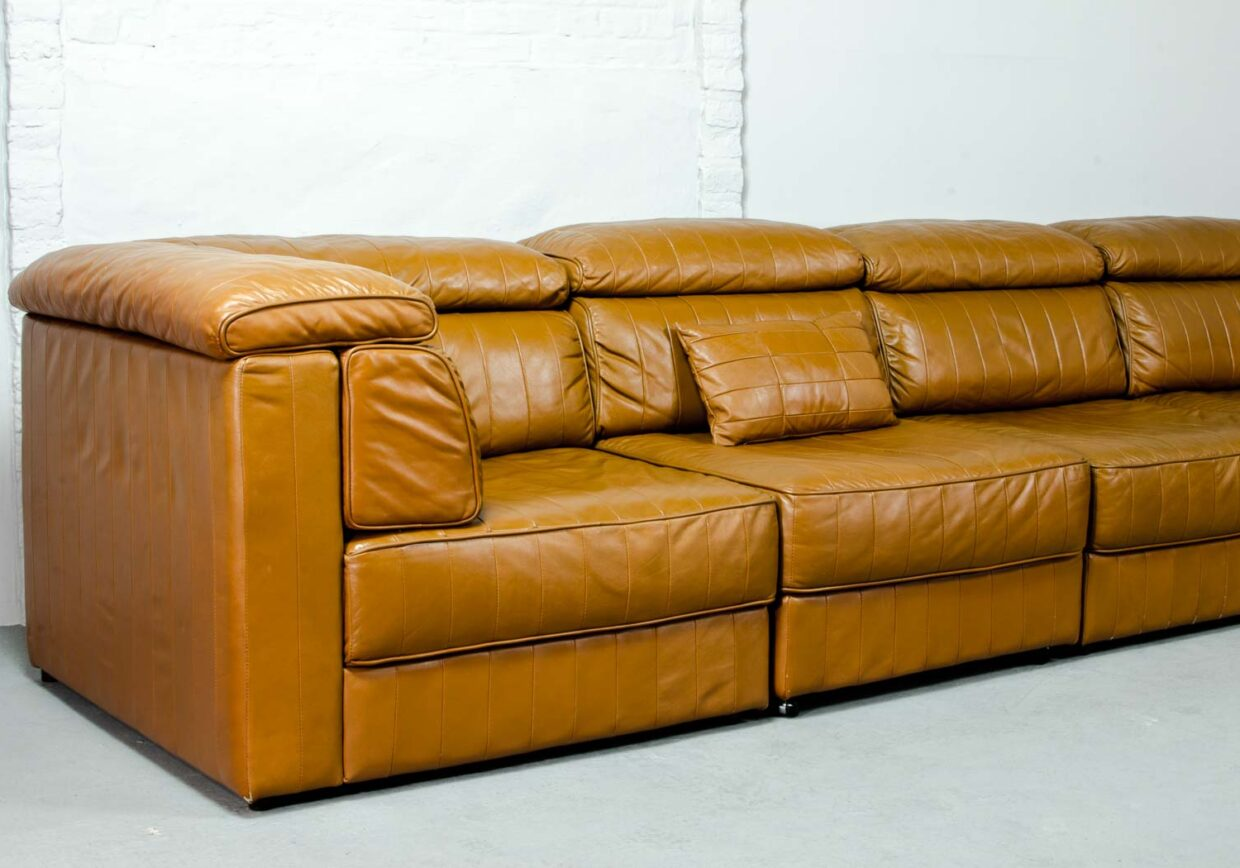 MID-CENTURY DESIGN MODULAR PATCHWORK COGNAC LEATHER SOFA FOR LAAUSER, GERMANY, 1970S