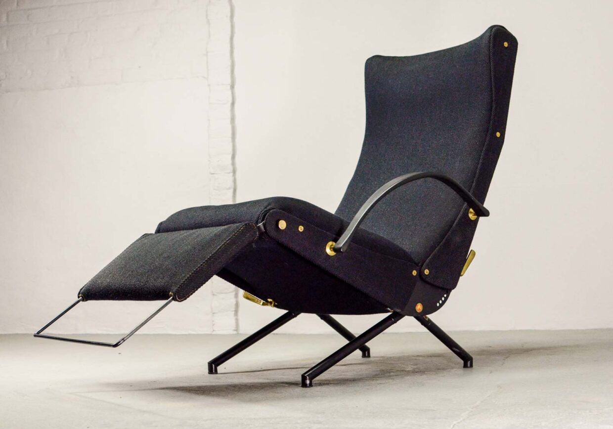 OSVALDO BORSANI FOR TECNO ORIGINAL FIRST EDITION P40 LOUNGE CHAIR IN BLACK AND BRASS. ITALY, 1950S.
